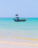White sand beach and pirate boat Stock Photos