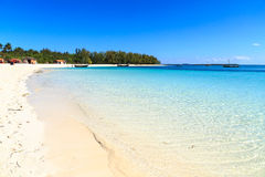 White sand beach of a resort on a tropical island Stock Images