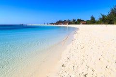 White sand beach of a resort on a tropical island Stock Photos