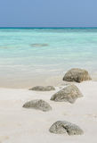 White sand beach with rock Royalty Free Stock Photography