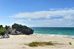 White sand beach with rocks and turquoise sea water Royalty Free Stock Photo