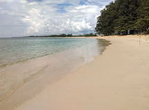 White sand beach with the sea and sky. Royalty Free Stock Photo