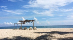 White sand beach with shacks and loungers Stock Image
