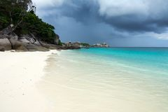 White sand beach and storm sky Stock Images