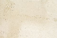 White sand beach top view photo. Smooth coral sand texture. Seaside wanderlust banner template with text place. Stock Photography