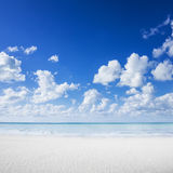 White sand beach, tropical ocean and blue sky Stock Photo