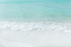 White sand beach and turquoise ocean background Stock Photography