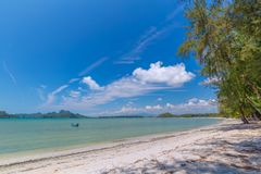 White sand beach , turquoise water and green lush trees on the foreground in south of Thailand.  royalty free stock photo