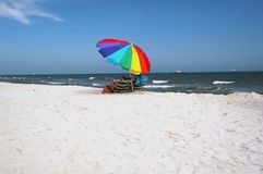 White Sand Beach with Umbrella Stock Photo