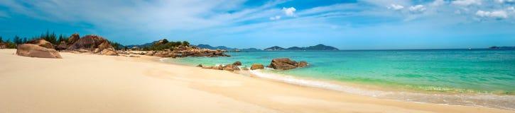 White sand beach. Vietnam. Panorama. Beautiful white sand beach. Stones on a foreground. Landscape of Vietnam. Panorama stock images