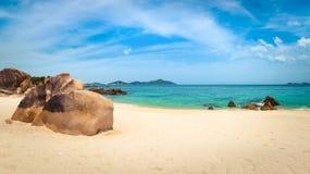 White sand beach. Vietnam. Panorama. Beautiful white sand beach. Stones on a foreground. Landscape of Vietnam. Panorama royalty free stock image