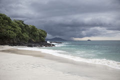 White sand beach with view for tropical storm Stock Images