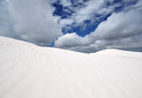 White Sand beach in Wedge Island Australia. Low angle of white sandy beach with cloud at the background stock image
