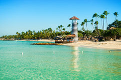 White sand, blue sea, clear sky and  lighthouse on shore Royalty Free Stock Images