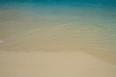 White sand and blue seawater Royalty Free Stock Image
