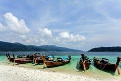 Lipe Island , Thailand. White sand , blue sky , Lipe Island ,Thailand with many boats Royalty Free Stock Photography