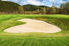 White sand bunker on the golf course Royalty Free Stock Photography