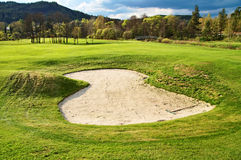 White sand bunker on the golf course Stock Photos