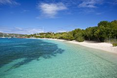 Pigeon Beach, Antigua. White sand and clear turquoise water at Pigeon Beach in Antigua stock photography