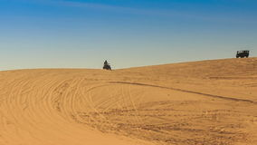 White Sand Dune Distant Quad Runs Jeep on Skyline stock footage