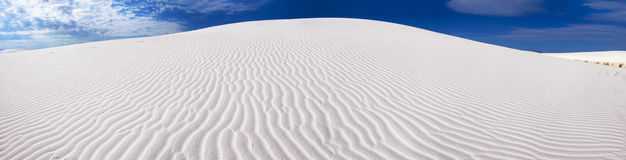 White Sand Dune Panorama. Panoramic view of a rippled sand dune in the White Sands of New Mexico Stock Photo
