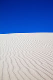 White sand dune with wind patterns Stock Photography
