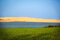 White Sand Dunes and blue lake, Mui Ne, Vietnam Royalty Free Stock Image