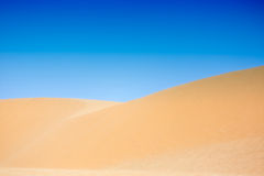 White sand dunes with blue skies, Mui Ne, Vietnam Royalty Free Stock Photos
