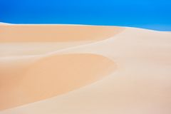 White sand dunes with blue skies, Mui Ne, Vietnam Royalty Free Stock Image