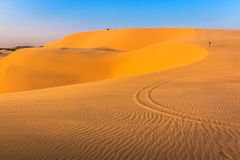 Desert Scene with Sand Patterns and Curves of White Sand Dunes at Mui Ne in The Evening Sunlight stock photos