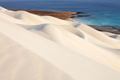 White sand dunes and sea Royalty Free Stock Photography
