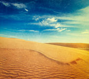 White sand dunes on sunrise, Mui Ne, Vietnam. Vintage retro hipster style travel image of  white sand dunes on sunrise, Mui Ne, Vietnam with grunge texture Royalty Free Stock Images