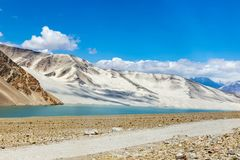 White Sand Lake along Karakorum Highway, Xinjiang, China. Connecting Kashgar and the Pakistan Border and crossing Pamir plateau, this road has some of the most stock images