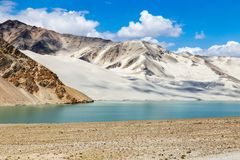 White Sand Lake along Karakorum Highway, Xinjiang, China. Connecting Kashgar and the Pakistan Border and crossing Pamir plateau, this road has some of the most royalty free stock photo