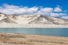 White Sand Lake along Karakorum Highway, Xinjiang, China. Connecting Kashgar and the Pakistan Border and crossing Pamir plateau, this road has some of the most royalty free stock photos