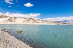 White Sand Lake along Karakorum Highway, Xinjiang, China. Connecting Kashgar and the Pakistan Border and crossing Pamir plateau, this road has some of the most royalty free stock images