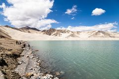 White Sand Lake along Karakorum Highway, Xinjiang, China. Connecting Kashgar and the Pakistan Border and crossing Pamir plateau, this road has some of the most royalty free stock photography