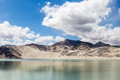 White Sand Lake along Karakorum Highway, Xinjiang, China. Connecting Kashgar and the Pakistan Border and crossing Pamir plateau, this road has some of the most stock image