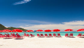 White sand with red umbrellas on the beach Stock Photo