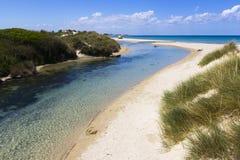 White sand of Salento. River that flows into the sea. Salento Stock Images