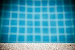 White sand stone pavement with pool edge Stock Photos