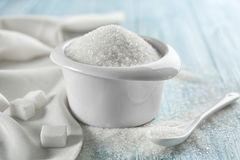 White sand sugar in bowl. On table royalty free stock photos