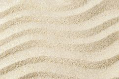 White sand texture background with wave pattern. Beach and sand background royalty free stock photo
