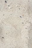 White sand texture. White sand and small stones texture and background Stock Images