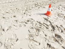 White sand with a traffic cone. White sand background with a traffic cone Royalty Free Stock Image