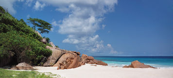 White sand tropical beach. Panoramic view of Grande Anse tropical beach, Seychelles, La Digue royalty free stock images