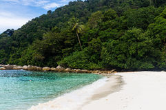 White sand Turtle beach at Pulau Perhentian, Malaysia. Relax on a deserted beach in an island of Tropical paradise. White sand Turtle beach at Pulau Perhentian Stock Photography