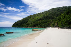 White sand Turtle beach at Pulau Perhentian, Malaysia. Relax on a deserted beach in an island of Tropical paradise. White sand Turtle beach at Pulau Perhentian Royalty Free Stock Photography