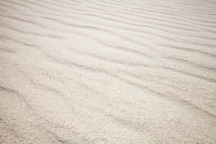 White sand with waves. Background texture Royalty Free Stock Photography