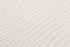 White sand with waves background texture Royalty Free Stock Photos